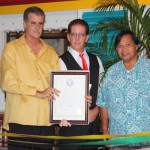 Senator Pangelinan (right), Frank Kenney (center) and Tim Murphy (left) during the Resolution Presentation and opening of the Jamaican Grill northern restaurant, November 16, 2011.