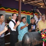 Senator Pangelinan (center), Frank Kenney (to Senator Pangelinan's immediate right), Tim Murphy (far right) and other join in during the Grill Lighting Ceremony in front of the Jamaican Grill northern resturaunt.
