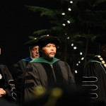 Senator Vicente Pangelinan on stage during the 2011 UOG Fall Commencement Ceremony