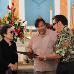 Senator Pangelinan (center) presents Resolution 328-31 to Mary Teresa Rhatigan (left). Former Senator Ted Nelson (right) joins the presentation.